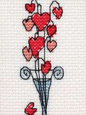 Hearts in Tall Glass Vase